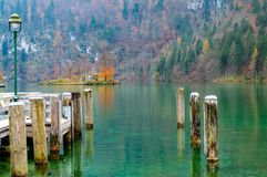 Konigsee lake in Berchtesgaden National Park. Konigsee lake in Berchtesgaden National Park in summer, Germany in a perfect aun day. Trees have yellow and red royalty free stock photography