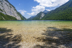 Konigsee lake. Germany. Crystal clear lake in the background of mountains Stock Photography