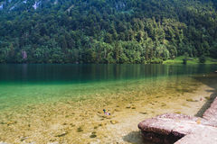 Konigssee lake with clear green water and reflection. Stock Image
