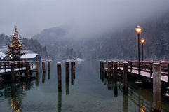 Konigssee lake winter scene. Wintry view of Christmas tree and lights on Lake Konigssee pier, Bavaria, Germany stock photos