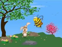 Konijn en een bij met een pot van honing stock fotografie