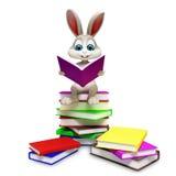 Konijntjeszitting op stapel van boeken Stock Afbeelding