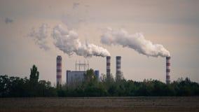 Konin, Poland. Working power station, smoking chimneys. Stock Photos