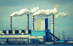Konin, Poland. Working power station, smoking chimneys. Stock Photography