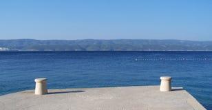 Konkret pir på stranden Royaltyfria Foton