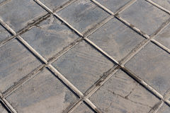 Konkret tegelplatta för utomhus- brukstrottoarer, icke-snedsteg och stenläggning för klädermotstånd Arkivbilder