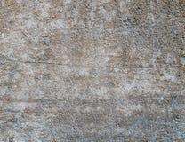 Konkret texturbakgrund med skrapor, sprickor och skada arkivbilder