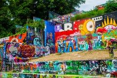 Konkret utomhus- måla Austin Graffiti väggcollage Royaltyfria Foton