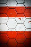 Konkrete sechseckige Bodenfliese mit den roten und weißen Streifen für BAC Lizenzfreie Stockfotografie