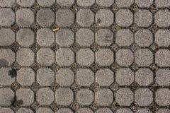 Konkreter Achteck-Bürgersteigs-Muster-Beschaffenheits-Zigaretten-Hintergrund Lizenzfreie Stockbilder