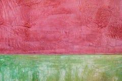Konkreter alter roter und grüner Hintergrund Stockfotografie