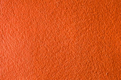 Konkreter orange Beschaffenheitshintergrund Lizenzfreie Stockfotos