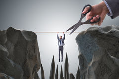 Konkurrensbegreppet med den hängande affärsmannen Royaltyfri Fotografi