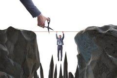 Konkurrensbegreppet med den hängande affärsmannen royaltyfri foto