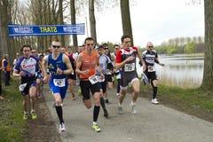 Konkurrenten, die weg laufen Stockfotos