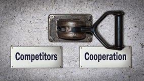 Konkurrenter för väggströmbrytaresamarbete kontra royaltyfri bild