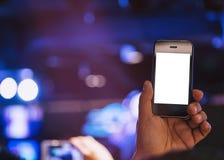 Konsert för suddighet för skott för foto för tom skärm för mobiltelefon för hand hållande royaltyfri fotografi