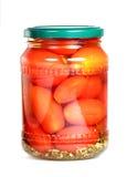 Konservierte Tomaten auf einem weißen Hintergrund stockbild