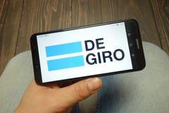 KONSKIE, ПОЛЬША - 5-ОЕ МАЯ 2019: Логотип компании брокерства Degiro показанный на смартфоне стоковое фото rf