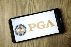 KONSKIE, POLAND - December 21, 2019: Professional Golfers Association of America PGA logo on mobile phone