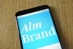 Alm Brand bank logo displayed on smartphone. KONSKIE, POLAND - February 15, 2019: Alm Brand bank logo displayed on smartphone stock photography
