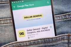 Dollar General - Digital Coupons, Ads and More app on Google Play Store website displayed on smartphone hidden in jeans pocket. KONSKIE, POLAND - JUNE 12, 2018 royalty free stock image