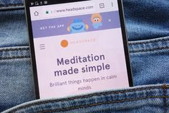 Headspace website displayed on smartphone hidden in jeans pocket royalty free stock image
