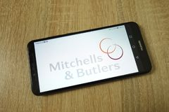 KONSKIE, POLAND - June 11, 2019: Mitchells and Butlers plc company logo on mobile phone