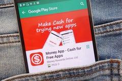 Money App - Cash for Free Apps on Google Play Store website displayed on smartphone hidden in jeans pocket. KONSKIE, POLAND - JUNE 12, 2018: Money App - Cash for stock image