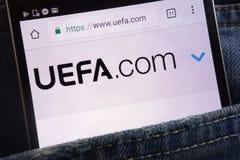 UEFA website displayed on smartphone hidden in jeans pocket royalty free stock photo