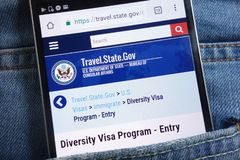 US Department of State website about Diversity Visa Program displayed on smartphone hidden in jeans pocket. KONSKIE, POLAND - JUNE 01, 2018: US Department of stock photo