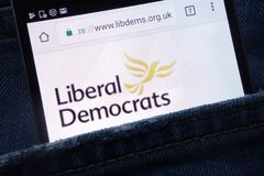 The Liberal Democrats political party website displayed on smartphone hidden in jeans pocket. KONSKIE, POLAND - MAY 18, 2018: The Liberal Democrats political royalty free stock photos
