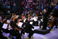 Konstantin Orbeljan met een orkest Stock Foto