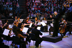 Konstantin Orbeljan with an orchestra. The big Moscow circus  New Year's attraction. On a photo: Konstantin Orbeljan with an orchestra Stock Photo