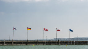 Konstanz, Germany: European flags on the lake shore Stock Image