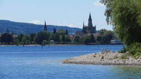 Konstanz. Germany seen from a distance.  The main cathedral is seen towering above the trees Royalty Free Stock Photo