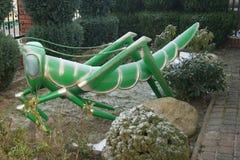Konstgjord gräshoppa Royaltyfria Foton