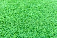 Konstgjord grönt gräs eller astroturf för bakgrund fotografering för bildbyråer