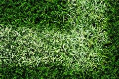 Konstgjord lawn för fotbollpitch arkivfoto