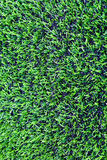 Konstgjort gräs av fotbollen & x28en; soccer& x29; fält arkivfoto