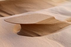 Konstiga sandbildande, som ser som skulpturer som skapas av vind arkivfoto