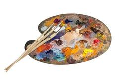 konstnären brushes palett s Arkivbild
