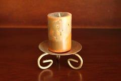 Konstnärlig stearinljus på en candleholder Fotografering för Bildbyråer