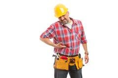 Konstruktörn med lever smärtar arkivfoto