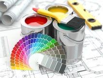 Konstruktion. Cans av målarfärg med den färgpaletten och målarpenseln. Arkivbild