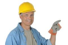 konstruktion som pekar arbetaren arkivfoton