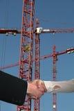 konstruktion sträcker på halsen handskakningen Arkivfoton
