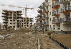 Konstruktionen av ett flerbostadshus - arbetsplats arkivbild