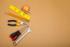 konstruktionshammaren tools fönstret royaltyfri foto