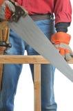 konstruktionshanden såg arbetaren Arkivfoton